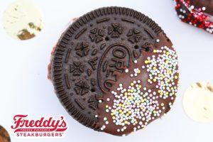 Freddy's OREO custard cookie sandwich dipped in chocolate