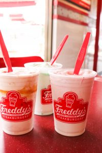 Freddy's Concretes in flavors Mint & Chocolate Chip, Strawberry & Cheesecake, and Cookie Dough & Caramel