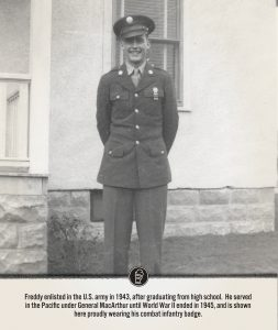 Freddy stands in his US Army uniform