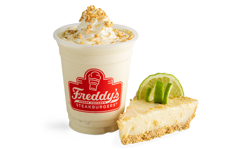 A key lime pie concrete from Freddy's sitting next to a slice of fresh key lime pie.